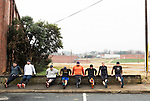 December 22, 2014. Lexington, North Carolina.<br />  (left to right) Frank Callicutt, Geoff Gardner, Christopher Allred, Stan Lanier, Dale Calhoun, Chris Phelps, Nicole Smith and Mayor Newell Clark do dips as part of their around town workout routine.<br />   Newell Clark, the 43 year old mayor of Lexington, NC, leads a group of friends and colleagues on a 4 times a week exercise routine around downtown. The group uses existing infrastructure, such as an abandoned furniture factory, loading docks, stairs, and handrails to get fit and increase awareness of healthy lifestyles in a town more known for BBQ.<br /> Jeremy M. Lange for the Wall Street Journal<br /> Workout_Clark