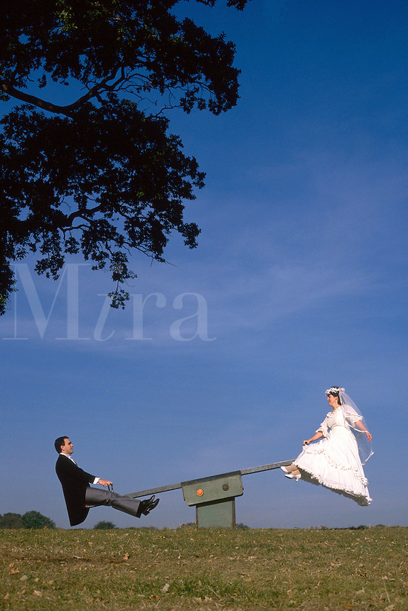 ..Wedding couple on see saw. MR