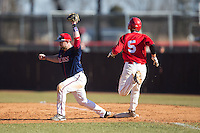 Shippensburg Raiders first baseman Jimmy Spanos (13) stretches for a throw as Drew Sipp (5) of the Belmont Abbey Crusaders hustles down the line at Abbey Yard on February 8, 2015 in Belmont, North Carolina.  The Raiders defeated the Crusaders 14-0.  (Brian Westerholt/Four Seam Images)