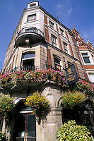 Architecture of corner pub The Barley Mow and beautiful flowers in London England
