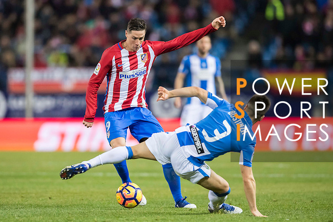 Fernando Torres (l) of Atletico de Madrid battles for the ball with Unai Bustinza of Deportivo Leganes during their La Liga match between Atletico de Madrid and Deportivo Leganes at the Vicente Calderón Stadium on 04 February 2017 in Madrid, Spain. Photo by Diego Gonzalez Souto / Power Sport Images