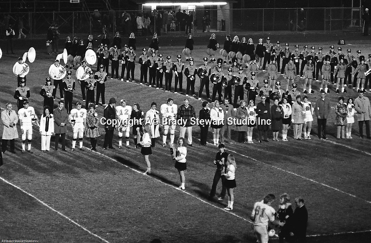 Bethel Park PA:  Bethel Park Band and Bethettes performing during Senior Night at Bethel Park High School Football field - 1970. Fathers and Mothers lining up with seniors to be recognized.  Seniors include; Scott Streiner, Mike Gomber, Allan Popovich, Mike Stewart, Lynn Reel, Paige Keenan, Geri Frey, Debbie Smith, and Cathy Clark.  Meeting parents below; Vic and Ray Tedesco.