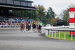 31 October 2009: Horses running in the first race round the bend in front of the grandstands at Keeneland. Keeneland's fall festival came to an undramatic end with overcast skies and low crowd numbers.