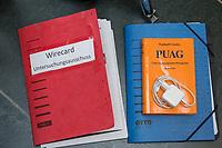 """Konstituierung des 3. Untersuchungsausschusses der 19. Wahlperiode (""""Wirecard"""") am <br /> Donnerstag den 8. Oktober 2020.<br /> Nach dem Zusammenbruch des Finanzunternehmens Wirecard hatten die Mitglieder des Deutschen Bundestag die Einsetzung des Wirecard-Untersuchungsausschuss beschlossen. Bundestagspraesident Wolfgang Schaeuble eroeffnete die konstituierende Sitzung.<br /> Im Bild: Eine Aktenmappe mit der Aufschrift """"Wirecard Untersuchungsausschuss"""" und ein Handbuch """"PUAG - Untersuchungsausschussgesetz"""".<br /> 8.10.2020, Berlin<br /> Copyright: Christian-Ditsch.de"""