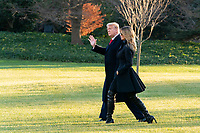 President Trump and the First Lady Depart for Florida<br /> <br /> President Donald J. Trump and First Lady Melania Trump walk across the South Lawn of the White House Wednesday, Dec. 23, 2020, before boarding Marine One to begin their trip to Florida. (Official White House Photo by Andrea Hanks)