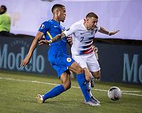 PHILADELPHIA, PA - JUNE 30: Jurien Gaari #13 defends against Paul Arriola #7 during a game between Curaçao and USMNT at Lincoln Financial Field on June 30, 2019 in Philadelphia, Pennsylvania.