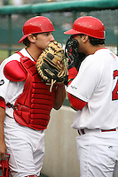 April 14, 2009:  Colt Sedbrook (22) and Paul Vazquez (24) of the Palm Beach Cardinals, Florida State League Class-A affiliate of the St. Louis Cardinals, try to keep entertained during a rain delay at Roger Dean Stadium in Jupiter, FL.  Photo by:  Mike Janes/Four Seam Images
