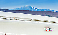 5 December 2014: Tucker West, sliding for the USA, banks through Curve 14 on his first run, ending the day with a 1st place finish and a combined 2-run time of 1:42.117 in the Men's Competition at the Viessmann Luge World Cup, at the Olympic Sports Track in Lake Placid, New York, USA. Mandatory Credit: Ed Wolfstein Photo *** RAW (NEF) Image File Available ***