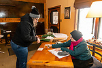 BETHLEHEM, CT. 21 December 2019-122119BS305 - Mother Angele, right, writes up a sale for Donna Achille of Shelton, during the annual holiday pop-up sale in the Jubilee Barn at the Abbey of Regina Laudis in Bethlehem on Saturday. Bill Shettle Republican-American