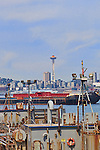 Seattle Skyline and Elliott Bay viewed over idle barges from Jack Block Park on Harbor Island.  An unusual view of Seattle from the heart of industrial Harbor Island. This image available for license through exclusive agency.  Please contact the photographer