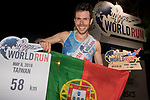 Luis Ricardo (C) of Portugal poses with national flag after winning The Wings for Life World Run along Taoyuan district on Sunday, May 6, 2018 in Taiwan. Photo by Victor Fraile / Power Sport Images
