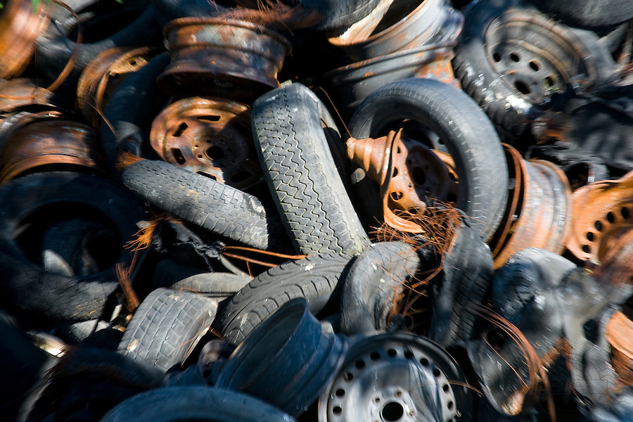 Pile of tires mixed with rusty parts. Center Focus.