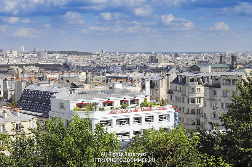 Cityscape of Montmartre district, Paris. White roofs of the parisian architecture