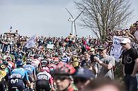 Peloton pedalling the cobbles through the crowds on sector n°25. <br /> <br /> 116th Paris-Roubaix (1.UWT)<br /> 1 Day Race. Compiègne - Roubaix (257km)
