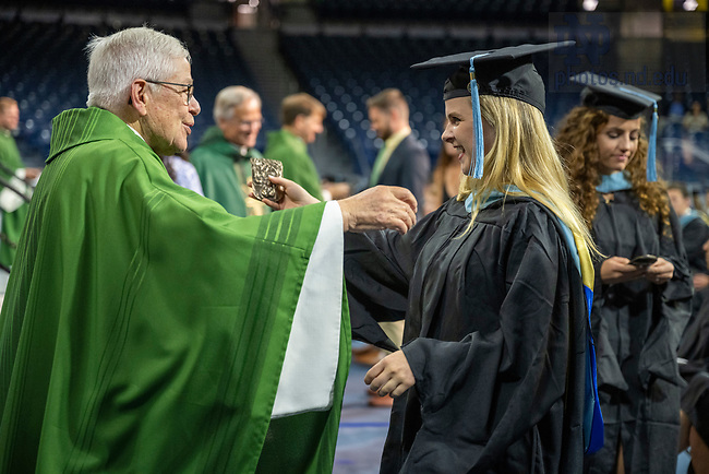 July 10, 2021; 2021 Graduates receive the ACE medal during mass after the Commencement Ceremony of the University of Notre Dame's Alliance for Catholic Education in the Purcell Pavilion. (Photo by Barbara Johnston/University of Notre Dame)