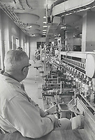 1969 FILE PHOTO - ARCHIVES -<br /> <br /> Bottling lines at the warehouse of the Liquor Control Board of Ontario; near foot of Yonge St. Going through is a run of LCBO beverage Alcohol. Ontario stocks of the Quebec favorite were depleted during Quebec Liquor Board strike. LCBO carries 1;322 listings; 46 bottled under LCBO label.<br /> <br /> PHOTO :  Jeff Goode - Toronto Star Archives - AQP