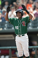 Great Lakes Loons outfielder Carlos Rincon (40) celebrates at the plate after scoring against the Bowling Green Hot Rods during the Midwest League baseball game on June 4, 2017 at Dow Diamond in Midland, Michigan. Great Lakes defeated Bowling Green 11-0. (Andrew Woolley/Four Seam Images)