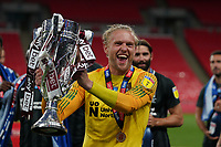 Goalkeeper David Cornell of Northampton Town celebrates promotion to League One with the trophy after a 4-0 victory in the Sky Bet League 2 PLAY-OFF Final match between Exeter City and Northampton Town at Wembley Stadium, London, England on 29 June 2020. Photo by Andy Rowland.