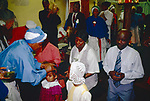 Mount Zion Spiritual Baptist church North London UK. Mother Noel  anoints members of the congregation This church service takes place in the front room of a small terraced house in north London. It is not entirely Christian. 1990s