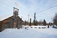 Jake Berkowitz passes by St. Luke's church as he arrives at the Shageluk checkpoint during Iditarod 2009