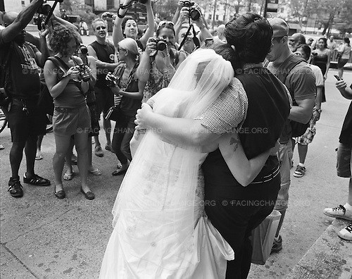 Brooklyn, New York<br /> July 24, 2011<br /> <br /> A lesbian couple leaves Brooklyn's municipal building after getting married on the first day that it was legal in New York State to do so.
