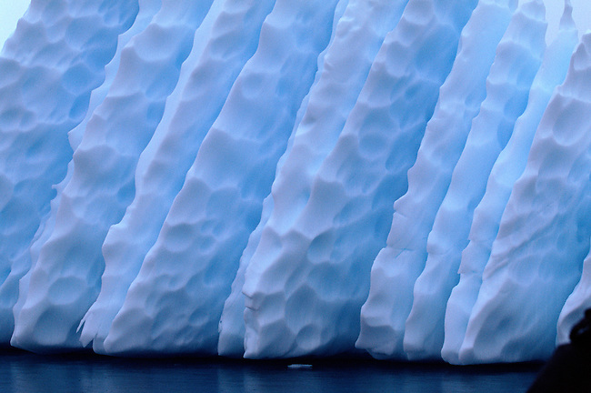 Ridges and dimples on an iceberg. Antarctica
