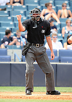 April 3, 2010:  Home plate umpire Travis Carlson makes a call in the annual Yankees Futures Game during Spring Training at Legends Field in Tampa, Florida.  Photo By Mike Janes/Four Seam Images