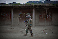 Marines patrol in Nishigham village in Nuristan. The day's mission was to re-supply an OP (Observation Post) that had been attacked the day before killing one ANA (Afghan National Army) soldier. The marines are acting as an ETT (Embedded Training Team) to mentor the ANA with the ultimate aim of leaving the country's security for the local Army to deal with.