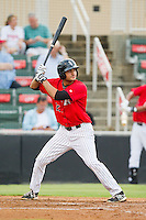 Nick Basto (27) of the Kannapolis Intimidators at bat against the Delmarva Shorebirds at CMC-Northeast Stadium on August 8, 2013 in Kannapolis, North Carolina.  The Shorebirds defeated the Intimidators 4-3.  (Brian Westerholt/Four Seam Images)