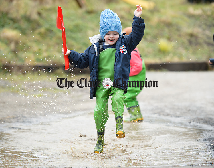 Phelim O Brien has fun in a puddle outside during a Pyjama Day party at Teach Spraoi, Toonagh as part of the annual Pyjama Day for Autism. Photograph by John Kelly.