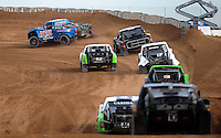 Dec. 10, 2010; Chandler, AZ, USA;  LOORRS pro two unlimited driver Robby Woods (99) leads a pack of drivers during qualifying for round 15 at Firebird International Raceway. Mandatory Credit: Mark J. Rebilas-US PRESSWIRE