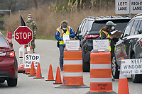 STONY BROOK, NEW YORK - APRIL 08: Workers at the COVID-19, Coronavirus testing site at Stony Brook university check I.D.'s of people coming to get tested on April 8, 2020 in Stony Brook New York.<br /> <br /> <br /> People:  Coronavirus Testing Site