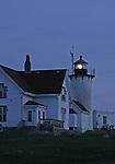 Eastern Point Lighthouse light shining at night. Gloucester, MA, U.S.