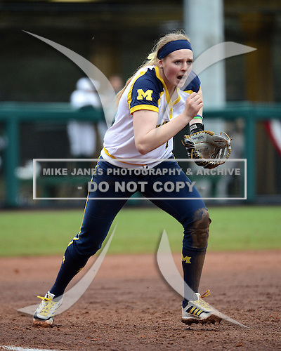 Michigan Wolverines utility player Kelsey Susalla (7) charges the ball during the season opener against the Florida Gators on February 8, 2014 at the USF Softball Stadium in Tampa, Florida.  Florida defeated Michigan 9-4 in extra innings.  (Copyright Mike Janes Photography)