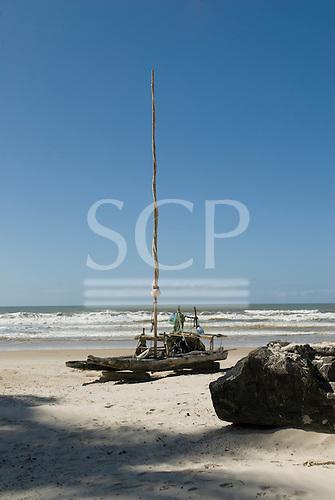 Bahia State, Brazil. Serra Grande beach (Praia da Pe, Pe de Serra Grande). Jangada fishing raft with sail on the beach.