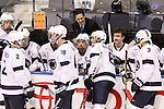 Penn State Head Coach Guy Gadowsky (top center) talks to his players during a time out in the second period. Penn State is winning 2-1 over RIT at Blue Cross Arena in Rochester, New York on October 20, 2012