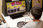 Education Preschool 3-4 year olds boy using computer to play educational game wearing headphones