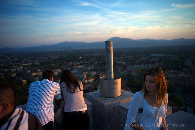 People take in the view from the Ljubljana Castle over the city of Ljubljana, Slovenia on Oct. 25, 2011.