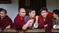 Buddhist monks and friends gather for social camaradie at the National Memorial Choeten, Thimpu, Bhutan