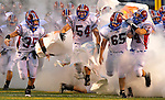 Huntsville players take the field before game except for player wh has tripped at botom center of photo.  Huntsville vs. Grissom High School football at Milton Frank Stadium.    Bob Gathany / The Huntsville TImes