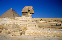 Profile of the Great Sphinx with the Great Pyramid of Giza in the background, Giza, Egypt.