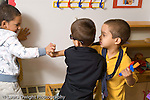 preschool 3-4 year olds conflict argument group of three boys having a conflict