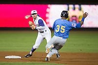 Jake Peter (3) of the Winston-Salem Dash prepares to turn a double play as Jeffrey Baez (35) of the Myrtle Beach Pelicans slides into second base at BB&T Ballpark on September 9, 2015 in Winston-Salem, North Carolina.  The Dash defeated the Pelicans 4-2 to take a 1-0 lead in the best of 3 series. (Brian Westerholt/Four Seam Images)