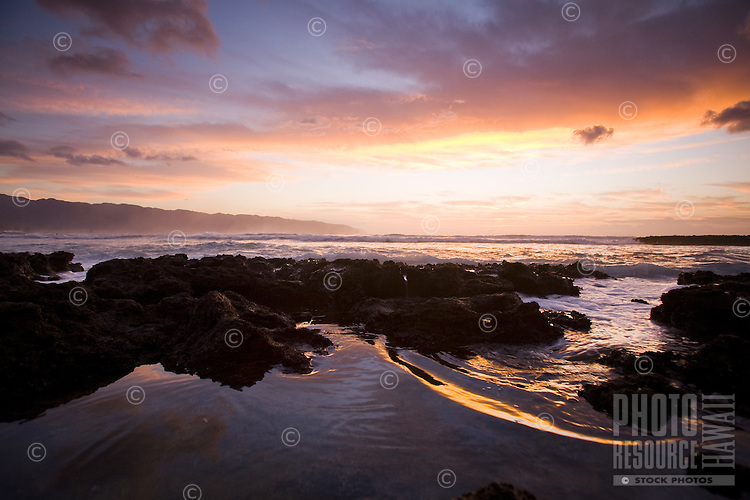 Sunset at Puaena Point, Haleiwa, on the North Shore of Oahu, with Kaena Point in the background