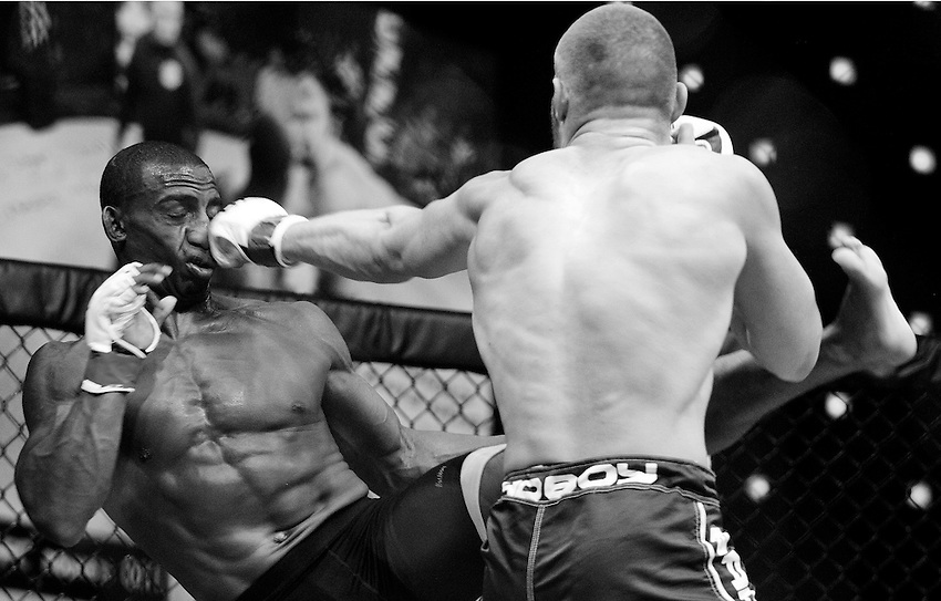 ATLANTIC CITY, NJ - (Aug. 17, 2013) -Mixed martial arts fighter Bradley Desir (left) is knocked off his feet by Christian Leonard, right, with a straight left to the nose during the second round of their 155-pound boat at Cage Fury Fighting Championship 26 in Atlantic City.