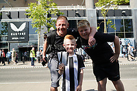 28th August 2021; St James Park, Newcastle upon Tyne, England; EPL Premier League football, Newcastle United versus Southampton; Newcastle supporters as a dad brings his son to his first premier league game