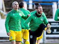 5th April 2021; Palmerston Park, Dumfries, Scotland; Scottish Cup Third Round, Queen of the South versus Hibernian; `Martin Boyle of Hibernian warms up before kick off in the early evening sun