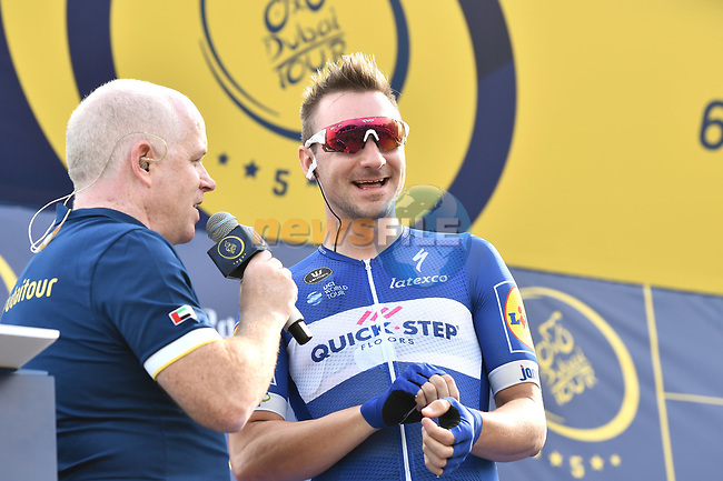 Elia Viviani (ITA) Quick-Step Floors talks with Anthony McCrossan at sign on before the start of Stage 2 The  Ras Al Khaimah Stage of the Dubai Tour 2018 the Dubai Tour's 5th edition, running 190km from Skydive Dubai to Ras Al Khaimah, Dubai, United Arab Emirates. 7th February 2018.<br /> Picture: LaPresse/Massimo Paolone | Cyclefile<br /> <br /> <br /> All photos usage must carry mandatory copyright credit (© Cyclefile | LaPresse/Massimo Paolone)