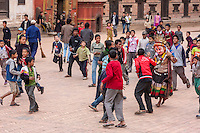 Bhaktapur, Nepal.  Students Running away from a Masked Figure in Durbar Square.