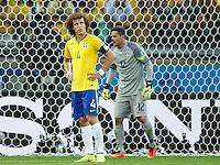 David Luiz of Brazil looks dejected with goalkeeper Julio Cesar